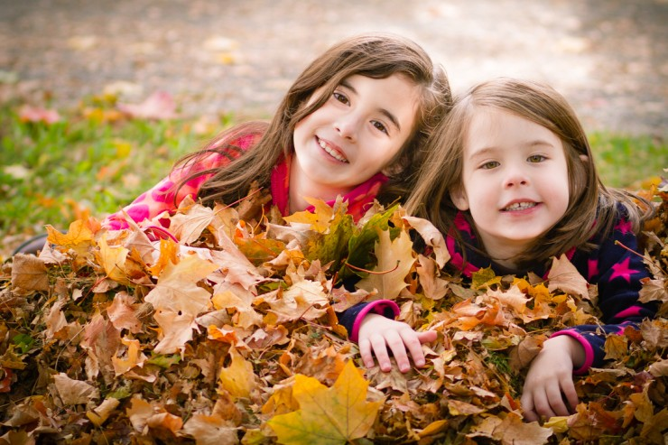 Girls playing in Leaves