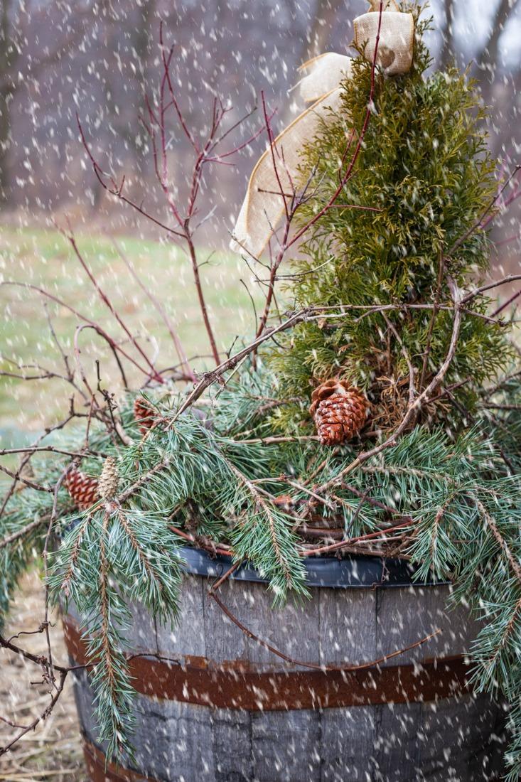 Rustic Cabin Christmas Porch, Whisky Barrel, and Door Garland | CreativeCainCabin.com
