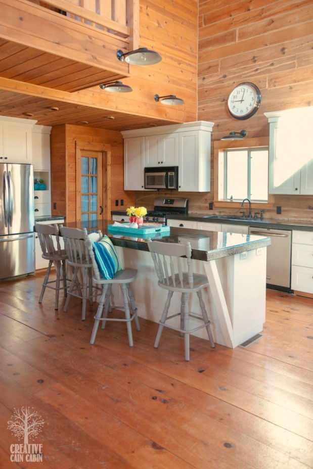 Log Home Kitchen | White Kitchen | Painted Bar Stools | Pops of Color | CreativeCainCabin.com