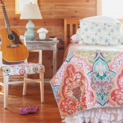 Colorful Bedroom With Jeweled Damask Quilt