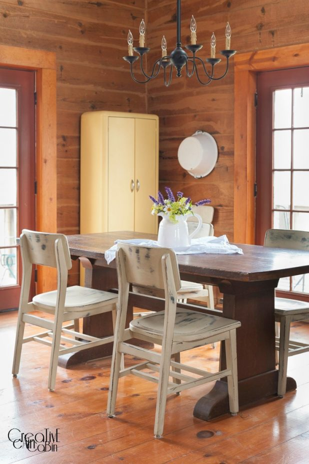 Summer Flower Arrangement Using Daisy's, Black and Blue Salvia, and Cora Bells in an Enamelware Pitcher   Summer Log Home   Dining Room   Wood Floors   Farmhouse Table   CreativeCainCabin.com