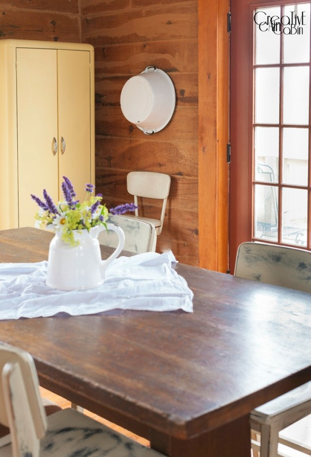 Summer Flower Arrangement Using Daisy's, Black and Blue Salvia, and Cora Bells in an Enamelware Pitcher | Summer Log Home | Dining Room | Wood Floors | Farmhouse Table | CreativeCainCabin.com