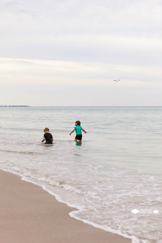 Children Playing in the Ocean | CreativeCainCabin.com