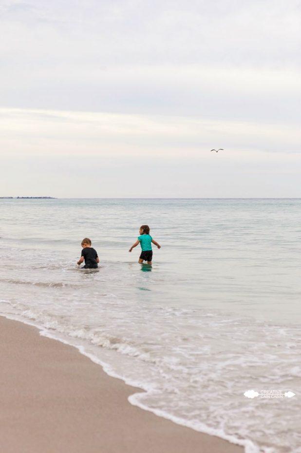 Children Playing in the Ocean | CreativeCainCabin.com