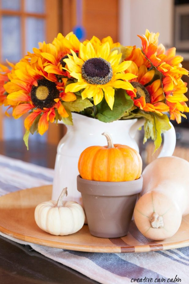Put Together An Easy Fall Kitchen Tray Using Faux Sunflowers, Pumpkins, Gourds, and Squash