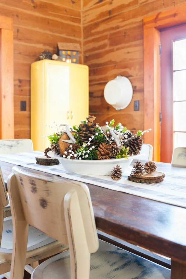 Winter Centerpiece Using a Variety of Pine Cones, Boxwood Clippings, Deer Antlers, Wood Slices and Faux White Berries