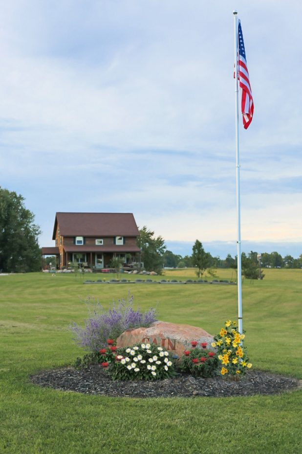 How to Install An In-Ground Flagpole and Landscape Around It
