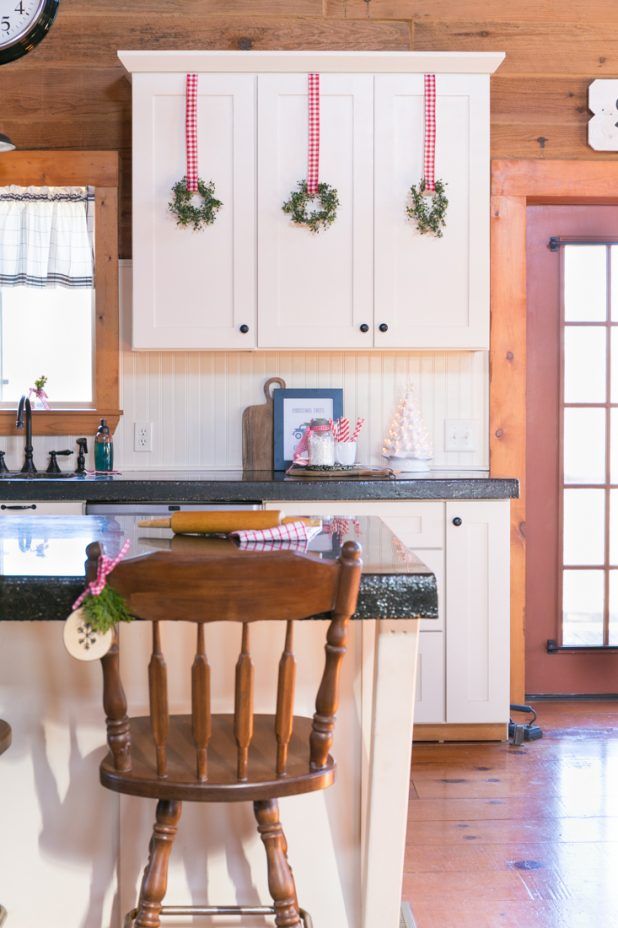 Christmas Kitchen in a Log Home Using Red & White Gingham, Plaid, Pinecones, and Wood Decorations