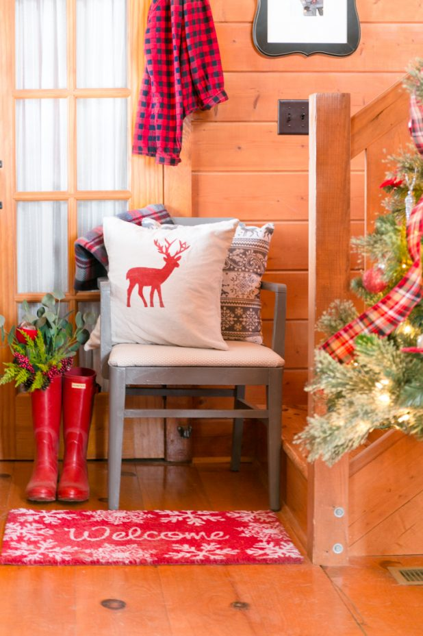Plaid Christmas Entry Way in a Log Home Done In Traditional Colors of Red, Gold, Silver, and Black