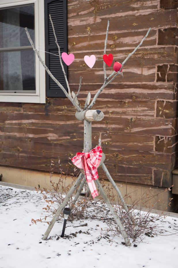 Rustic Wooden Deer Decorated For Valentine's Day