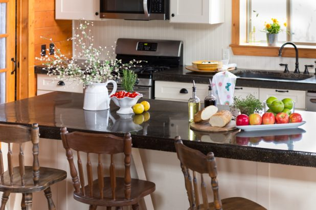 Kitchen Loaded With Colorful Vegetables, Bread, Herbs, and Flowers