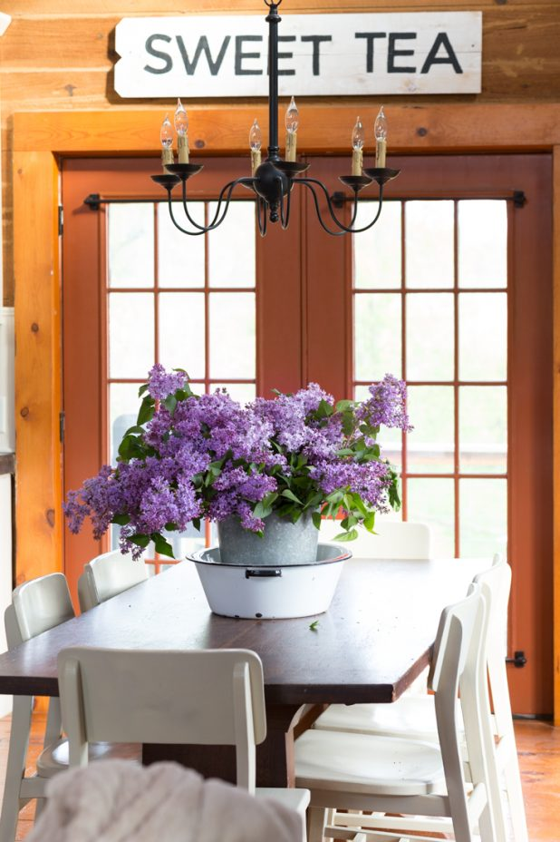 Cut Purple Lilac Blooms In a Galvanized Sap Bucket and Enamelware Dish Pan