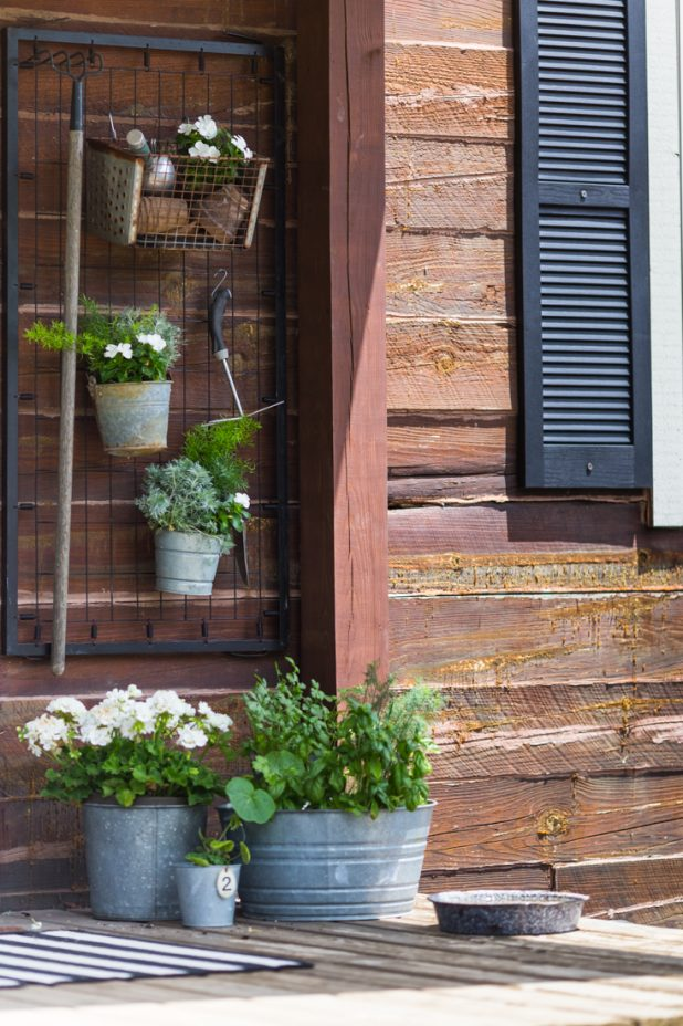 Don't throw away that old baby crib, keep the springs and turn them into a storage area for garden tools using s-hooks. You can even hang galvanized buckets filled with flowers for living wall art.