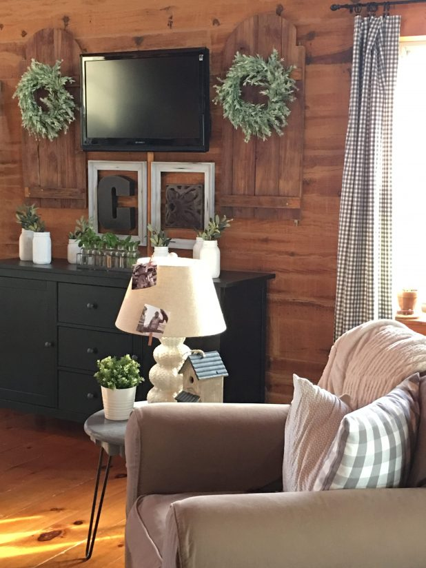 Decorating Around a Wall Mounted TV To Create A Gallery Wall Using Rustic Farmhouse Finds, An Old Barn Ladder, Swinging Saloon Doors, Painted Mason Jars, Rustic Frames and Olive Branches