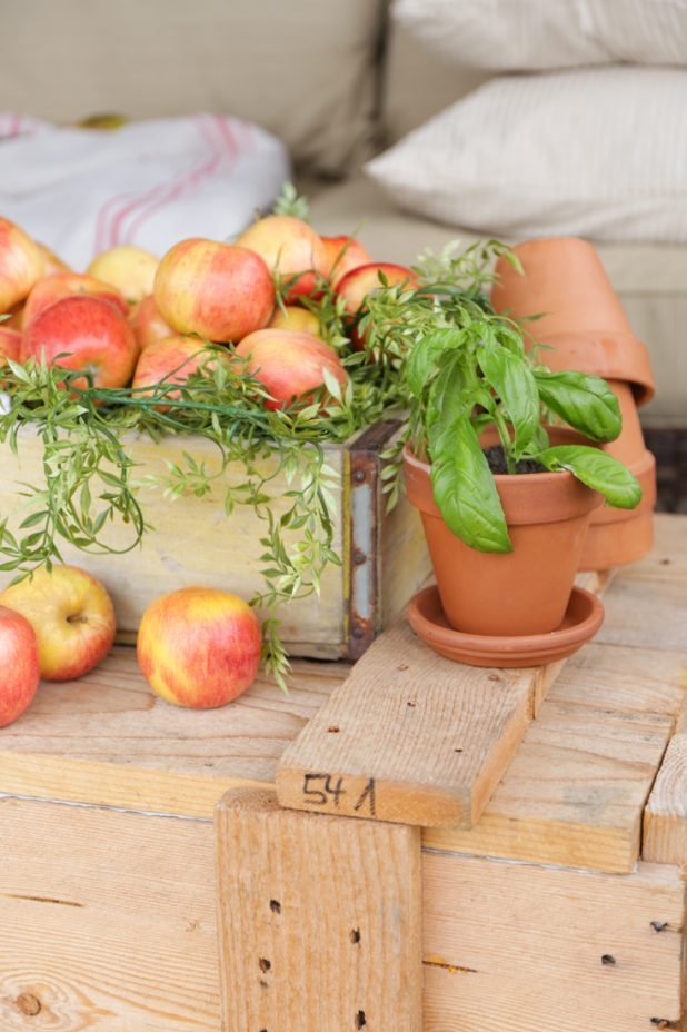Fall Porch Decor Using Apples, Herbs, and a Rustic Shipping Crate
