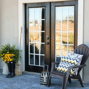 Painted Black French Doors On A Walkout Basement, Stamped Concrete Patio
