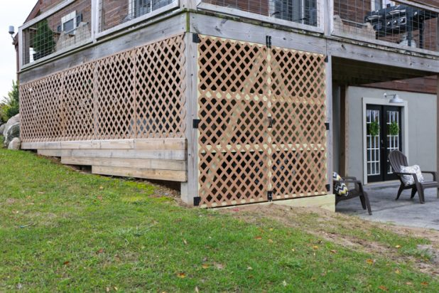 Enclose a Second Story Deck Underside to Create a Storage for Gardening Supplies