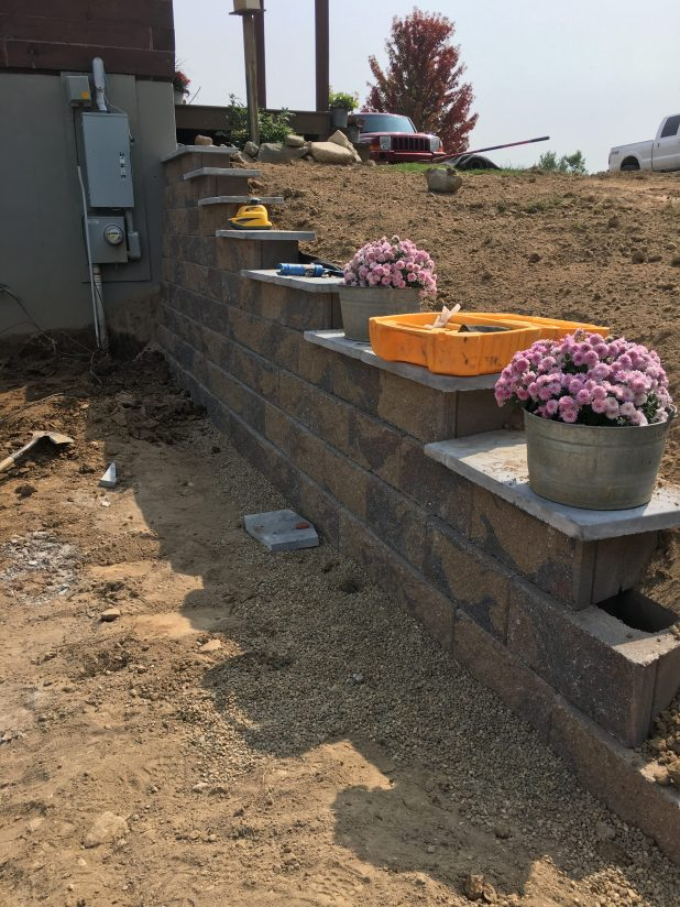 Walkout Basement Retainer Wall Build Using Split Face