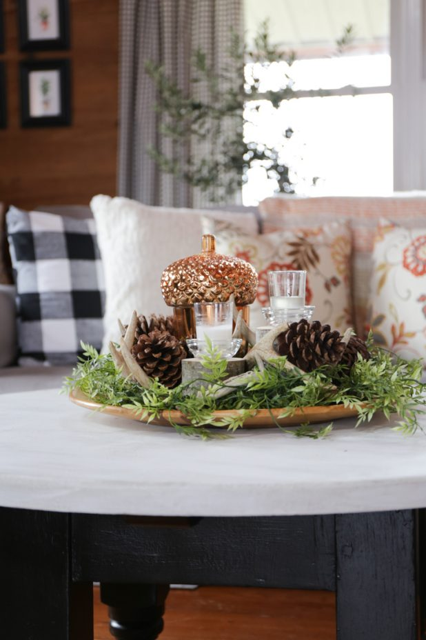 Rustic Fall Centerpiece Using Natural Elements, Deer Antlers, Pine Cones, Candles, Wood Slices, Greenery, and a Large Copper Acorn