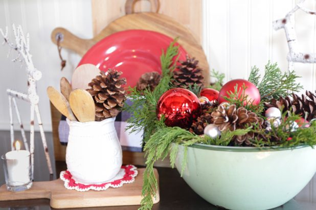Vintage Green Enamelware Bowl Filled with Christmas Ornaments, Pine Clippings, and Pinecones