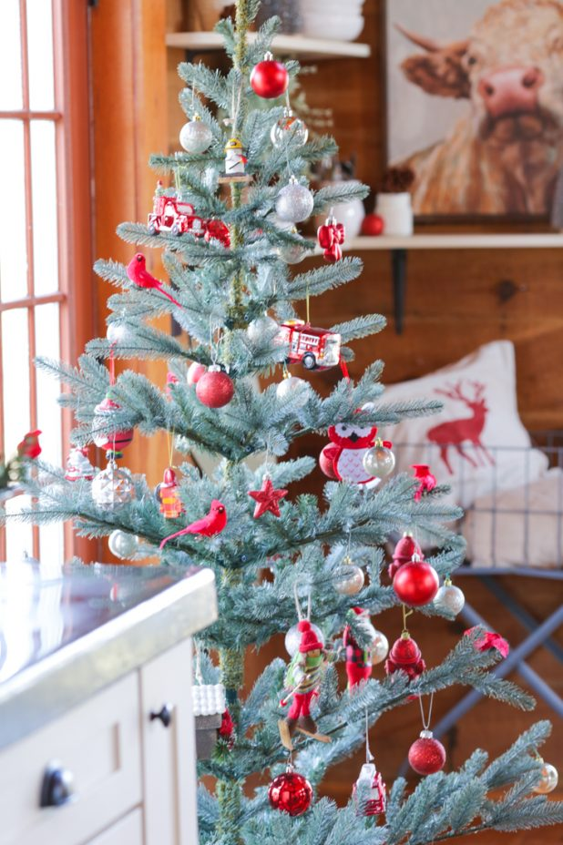 Christmas Tree in the Dining Room of a Log Home Decorated With Firefighter Ornaments