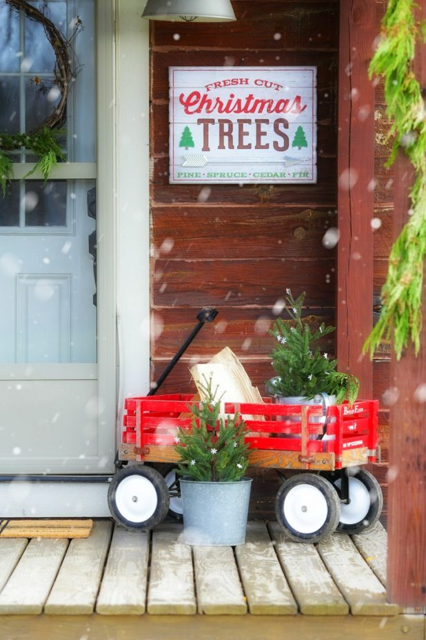 Rustic Log Home Christmas Porch, Fresh Cut Pines, Vintage Red Wagon, Grapevine Wreath, Pine Clippings, and Galvanized Buckets,