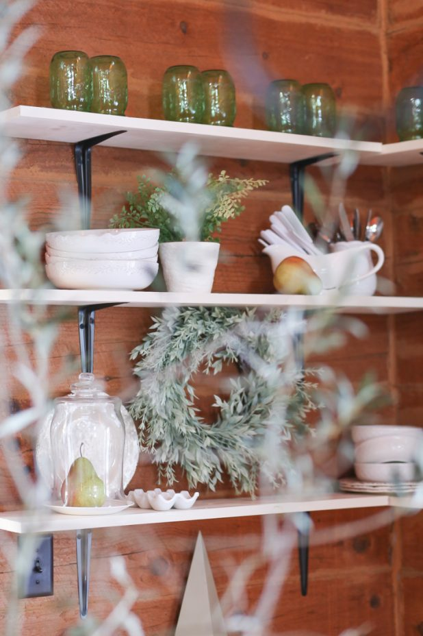 White Dishes With Pops of Green On Open Farmhouse Shelves