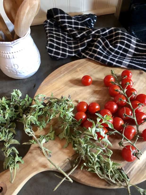 Cherry Tomatoes, Oregano, on a Vintage Cutting Board