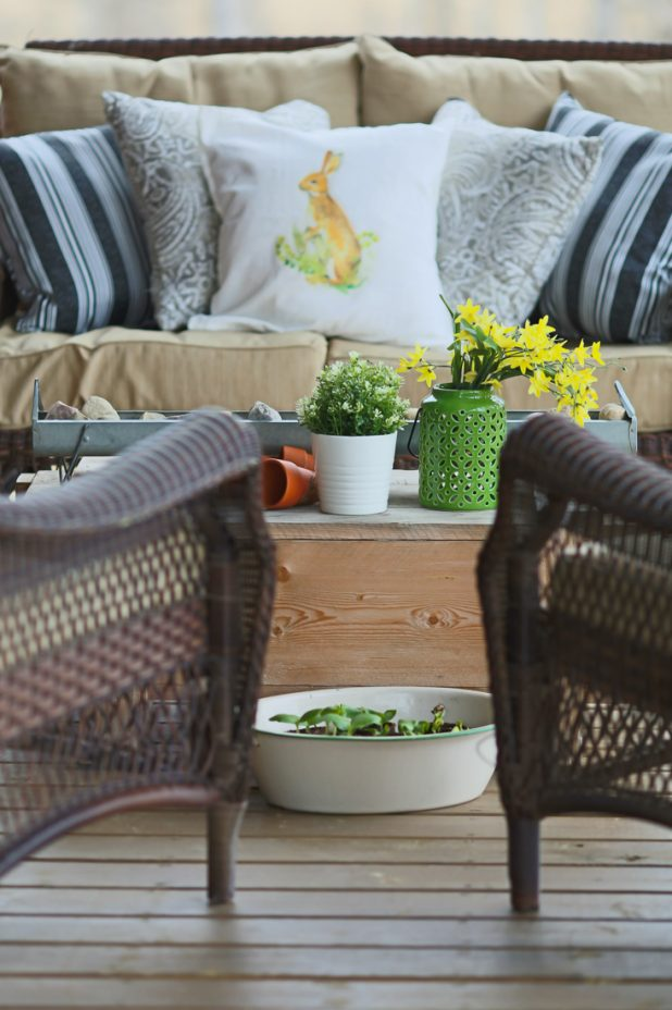 Early Spring Porch Decorating Using Neutrals with a Pop of Green. Pottery Barn Bunny Pillow Knockoff. Neutral Pillows From Walmart, Better Homes and Garden Line. How To Make a Porch Feel Like Spring Even Before Things Are Blooming