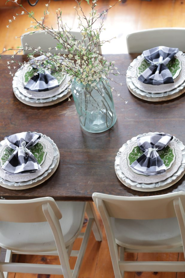 Spring Farmhouse Table Setting With Black, White, and Green.