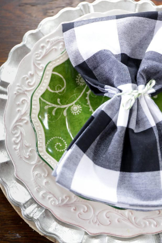 Spring Table Setting Using Black, White, and Green. Galvanized Chargers, White Distressed Dinnerware, Green Salad Plate and Buffalo Check Napkin
