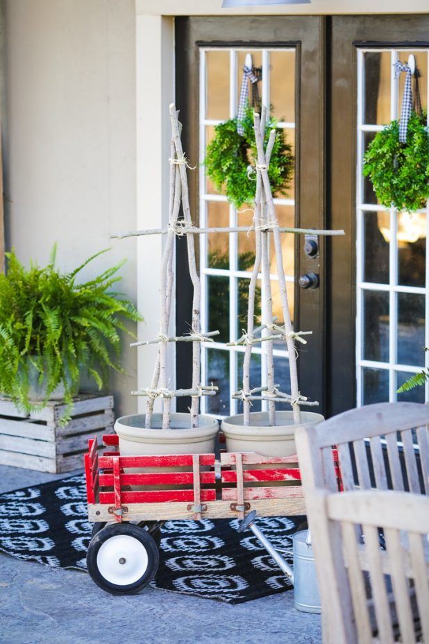 Patio Tomatoes Planted in a Vintage Red Wagon with Handmade DIY Tomato Cage