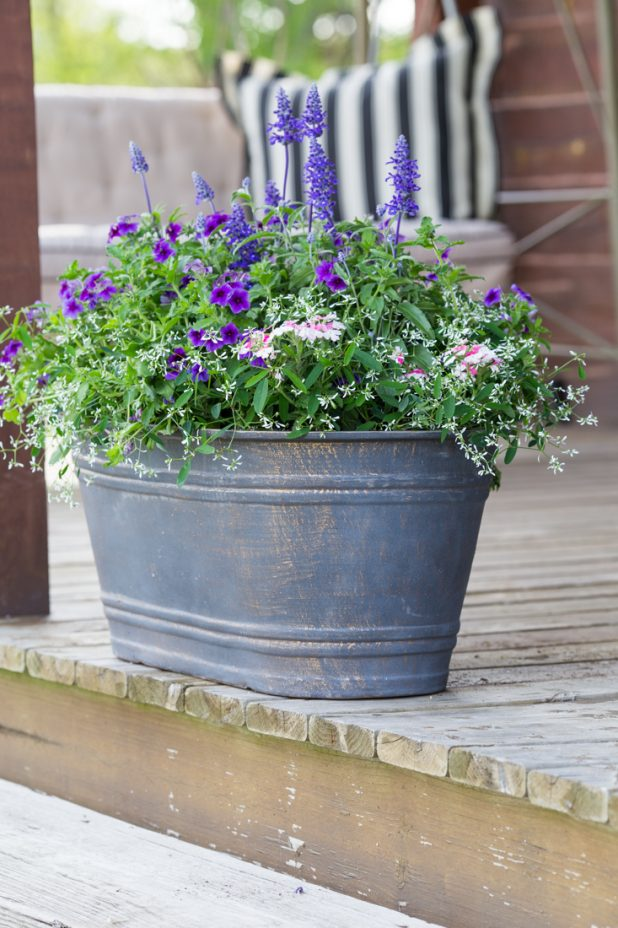 Adding Flower Containers To a Front Porch For Curb Appeal