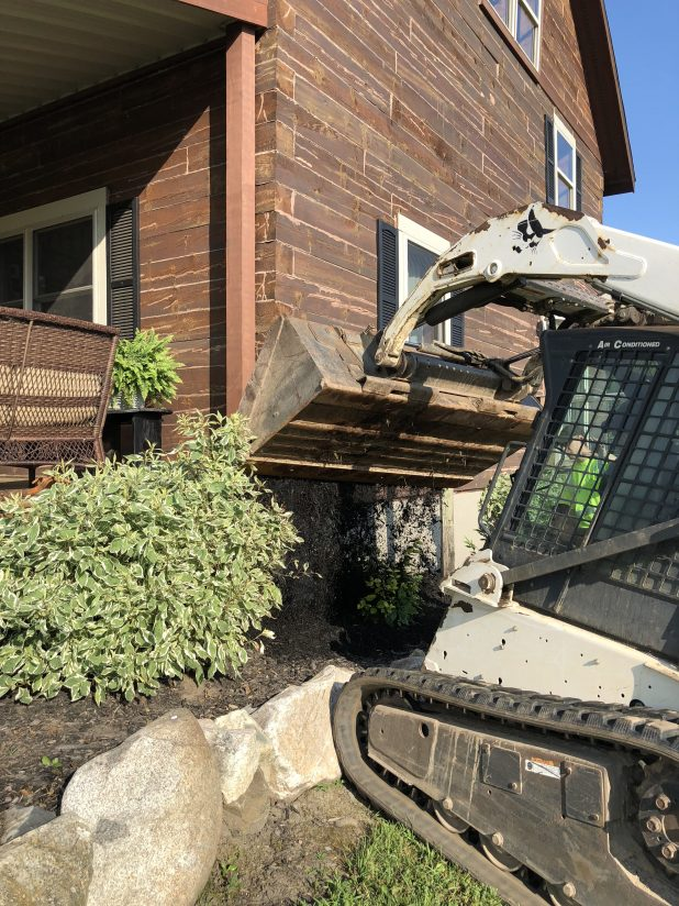 Adding Fresh Mulch to the Landscaping