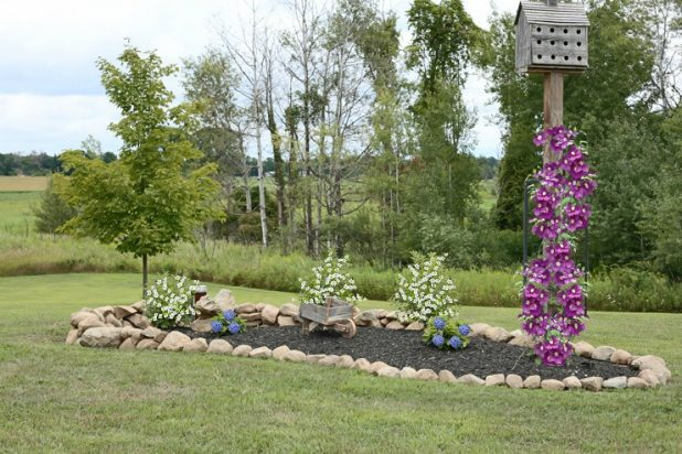 Landscaping with large rocks as a boarder to a planted area