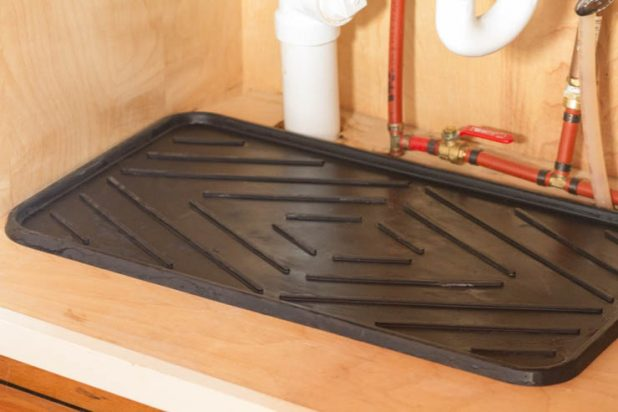 Boot tray under sink for plumbing drips