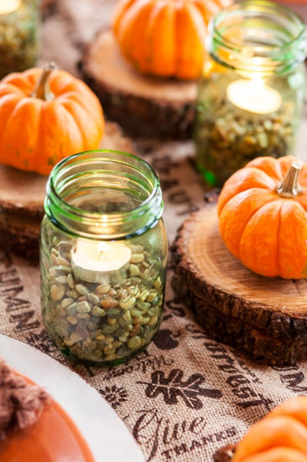 Easy Last Minute Thanksgiving Table Using Pebbles, Rosemary, Burlap, Wood, Pumpkins, and Candles | creativecaincabin.com