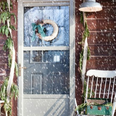 Rustic Christmas Porch and Whisky Barrel Decor