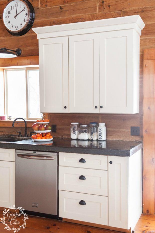 Log Home Kitchen with White Cabinet & Black Concrete Countertops | creativecaincabin.com