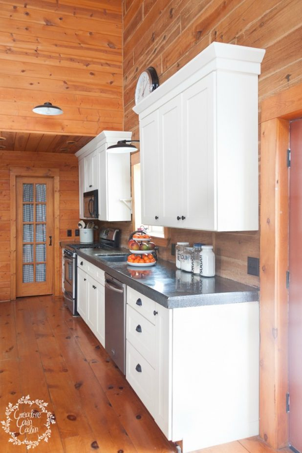 Log Home Kitchen with White Cabinet & Black Concrete Countertops   creativecaincabin.com