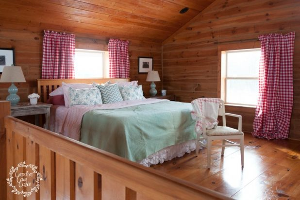Master Bedroom in a Log Homes Loft | Buffalo Check Fabric and Turquoise Pops of Color | Creativecaincabin.com