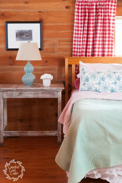 Master Bedroom in a Log Homes Loft   Buffalo Check Fabric and Turquoise Pops of Color   Creativecaincabin.com