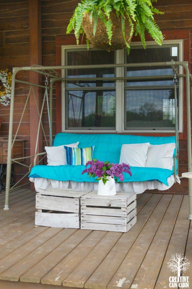 Summer Log Home Turquoise Porch   CreativeCainCabin.com