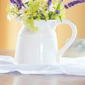 Summer Flower Arrangement Using Daisy's, Black and Blue Salvia, and Cora Bells in an Enamelware Pitcher | CreativeCainCabin.com