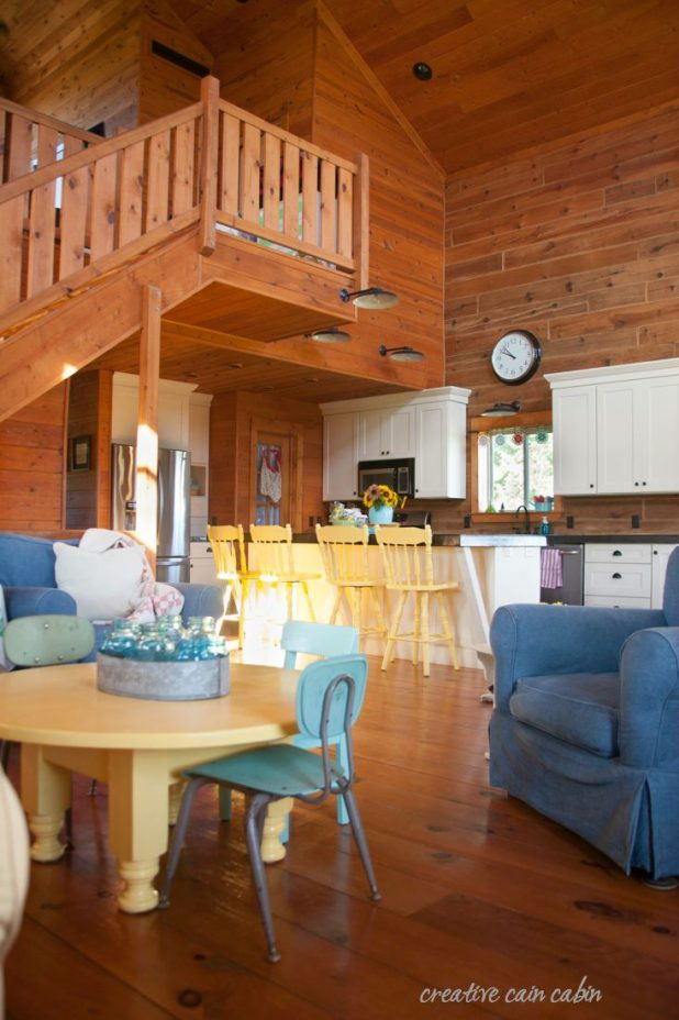 Painted Bar Stools in Soft Duckling Yellow Add a Pop of Color to this Log Homes Kitchen