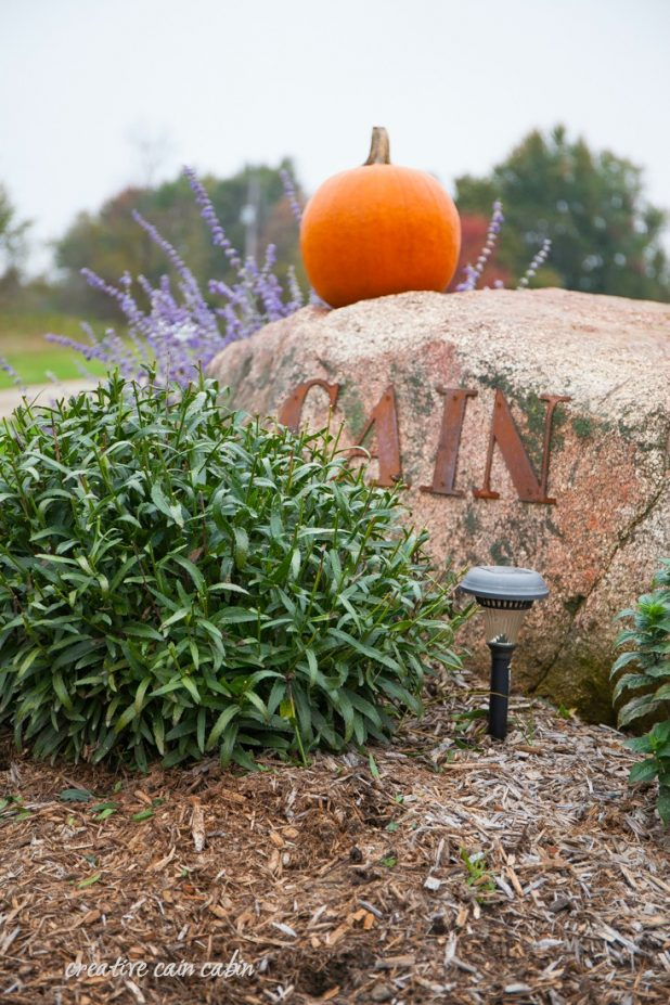 Easy Rustic Entrance Marker Decorated for Fall With a Single Pumpkin