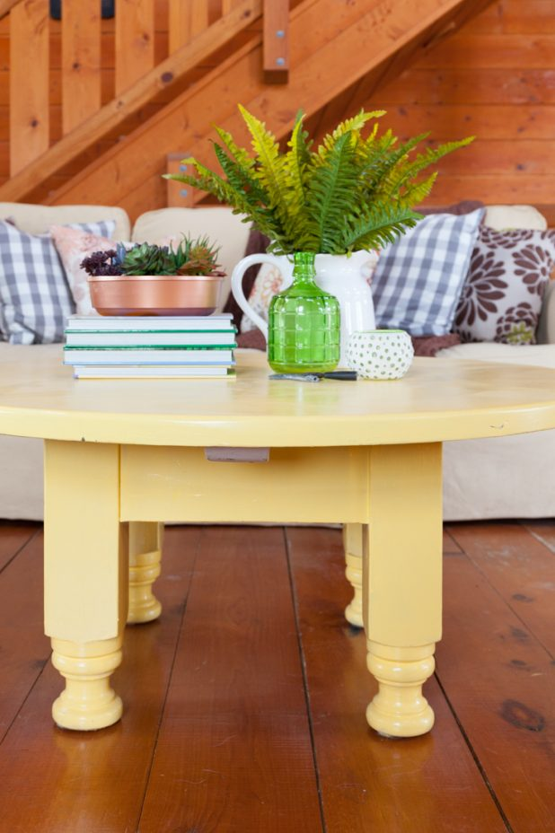 Coffee Table Vignette Using Succulents, Ferns, Books for Height, and Green Glassware