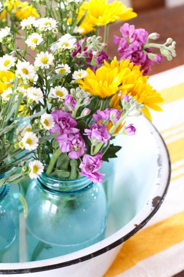 Farmhouse Centerpiece Using Enamelware, Blue Mason Jars, and Wild Flowers