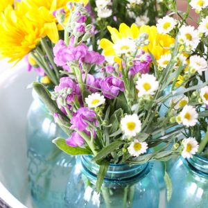 Farmhouse Centerpiece Using Enamelware, Blue Mason Jars, and Wild Flowers