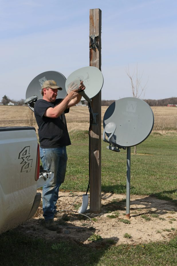 Taking Down Old Satleite Dishes and Using the Pole for a Purple Martin House